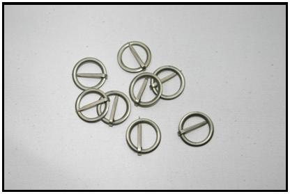 TIN RING BROOCHES